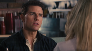 "Tom Cruise as Jack Reacher, listing the ""four types"" to Rosamund Pike's Helen Rodin."