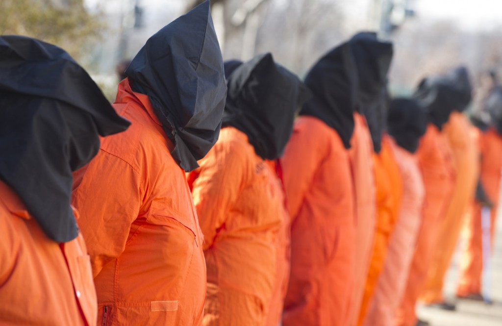 Protestors-wear-orange-prison-jumpsuits-and-black-hoods-on-their-heads-during-protests-against-holding-detainees-at-the-military-prison-in-Guantanamo-Bay-during-a-demonstration-on-Capitol-Hill-in-Washington-D.C.-on-January-8-2