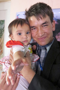 Ali, one of the Afghan Peace Volunteers who assisted the five Kunduz families, including the toddler named Rana in the photo
